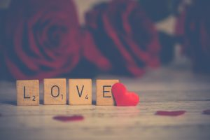 scrabble titles showing love to illustrate love language